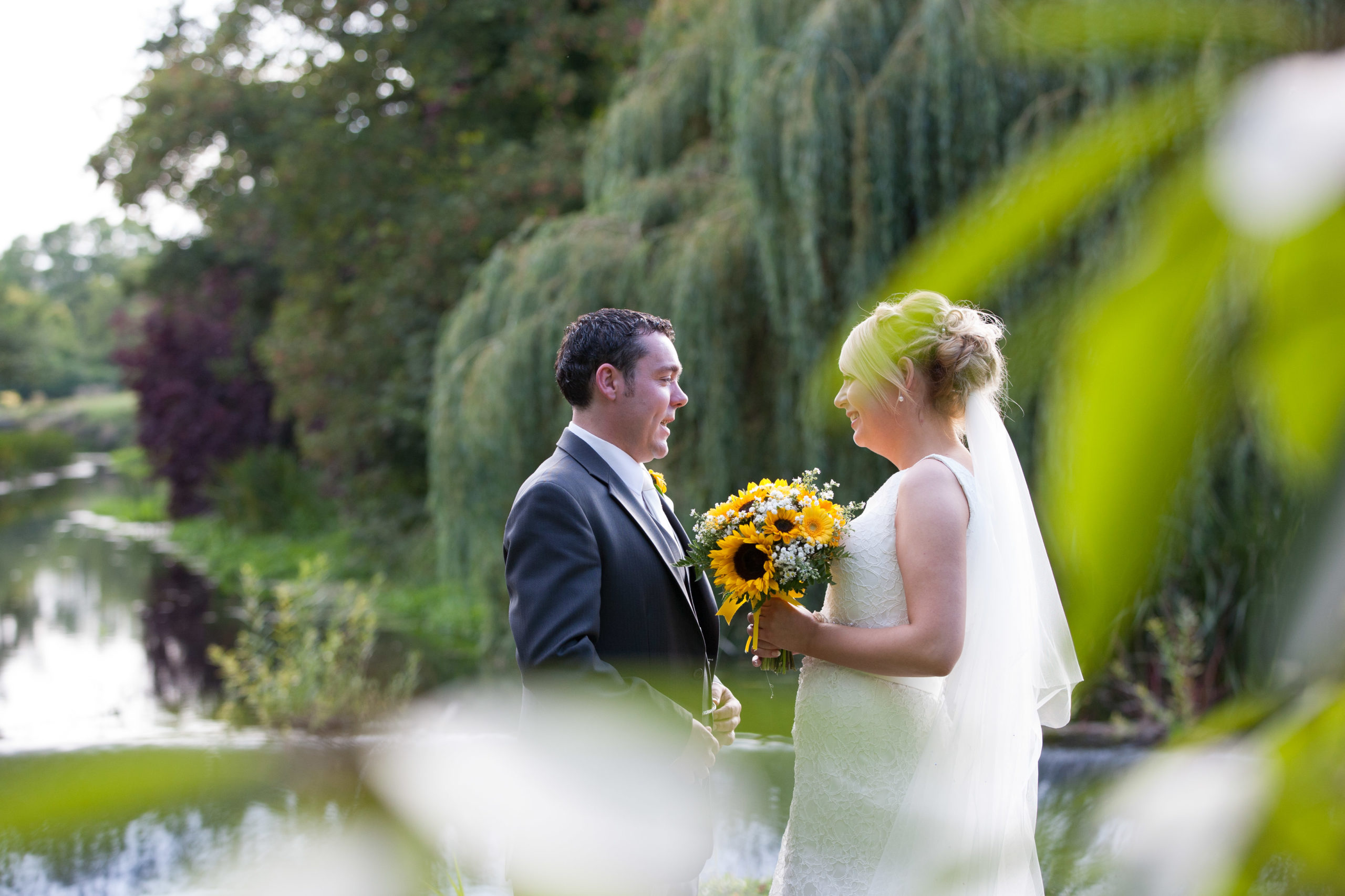 Wedding couple at the weir at Bellingham castle